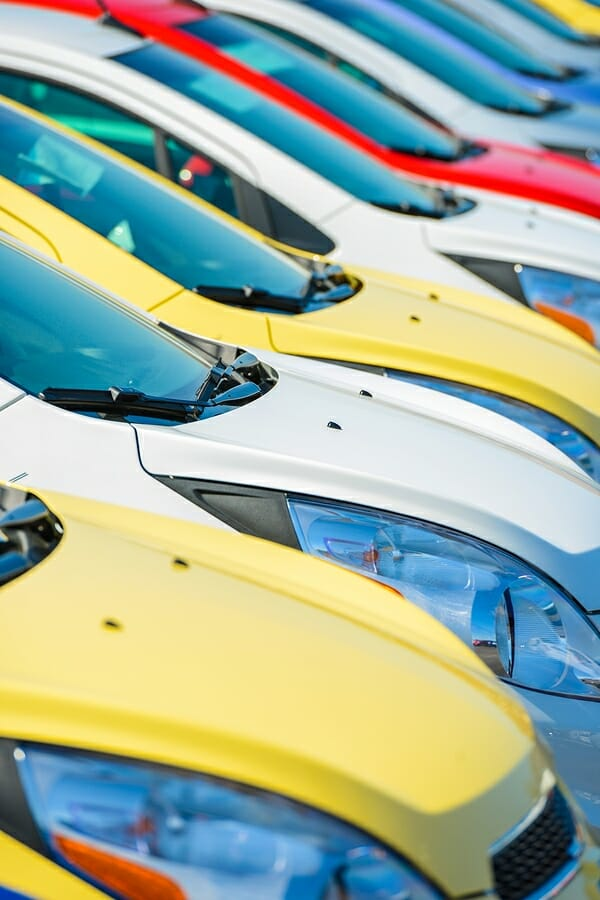 Colorful Cars Stock. Car Dealership Vehicles Stock Vertical Photography.